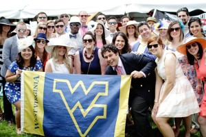 West Virginia University Alumni gather for their #URow2015 tent photo!